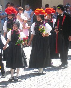 Women with Bollenhut hats. Tradional costume worn by three neighboring Black forest villages of Gutach, Kirnbach and Reichenbach. Young unmarried girls wear red pompoms on their hats and married women wear hats with black pom-poms.