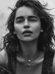 Emilia Clarke wears form-fitting dresses,sculptural outerwear as well as elegant gems Pose on Dior Magazine 2015 Photoshoot