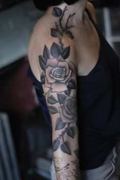 A black and grey rose 1/2 sleeve tattoo. Very feminine and pretty!
