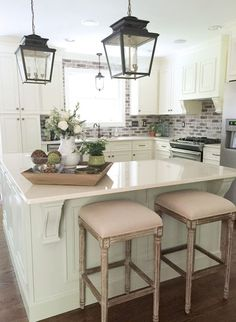 Classic Charleston Style Farmhouse Kitchen with brick backsplash, painted island and lantern pendant lights   Beth Hart Designs #farmhousekitchen