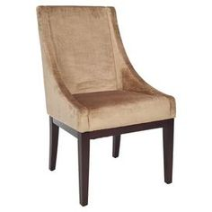 Faux velvet swoop arm chair with dark champagne upholstery and exposed wood legs.Product: Chair    Construction Material: Velveteen and wood    Color: Champagne      Dimensions: 39 H x 23 W x 26 D