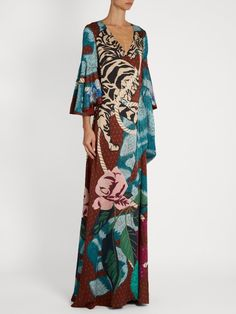 Temperley London Catalina Silk Crepe de Chine Gown. It's a Big Abstract Floral with Swirling Reds, Pinks and Tonal Greens. It has a Classic Wrap Silhouette with a Deep V-Neck, Wide Waist Tie and Flared Sleeves. The Skirt is A-Line and Touches the Floor. I've picked up the Greens with a Multi-Strand Tourmaline Necklace, Earrings, & Paraiba Ring. Finish with Soft Silver Sandals and Clutch - Toss on a Lacy Ivory Shawl (It's all on this board). So, what do you think? Pretty, Huh? - Gabrielle