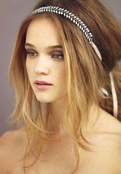messy hair updo secured with a chic hairband + pewter eyes
