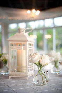 El candil con la vela y la mini-pecera con dos flores   coastal style