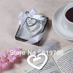 "Aliexpress.com : Buy FREE SHIPPING ""Love Story"" Metal Heart Shaped Bookmark With Tassel Wedding Favor Party Birthday Baby Shower gifts from Reliable bookmark baby shower favors suppliers on China-Gifts's Store $17.50"