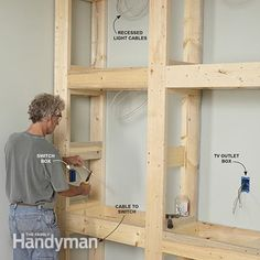 Rough-in the wiring for the built-in entertainment center and bookcase. – Showcase Built-In Bookcase Plans: www. Woodworking Workshop, Woodworking Bench, Fine Woodworking, Woodworking Projects, Woodworking Videos, Youtube Woodworking, Woodworking Equipment, Woodworking Supplies, Woodworking Techniques