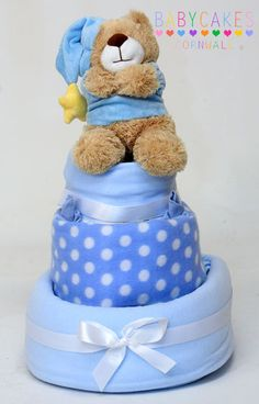 3 tier nappy cake, wrap the blankets around the diapers.