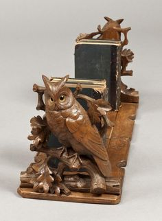 For Sale on - A whimsical black forest book rack Of adjustable form, constructed in carved Lime wood, having horned owls with glass eyes, set on the folding uprights, Wood Sculpture, Sculptures, Forest Book, Real Wood Furniture, Black Forest Wood, Owl Books, Book Racks, Antique Collectors, Book Stands