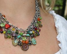 This colorful necklace makes a statement in chunky Czech Glass. This is Yay Jewelry's signiture designsand my favorite. It is a triple strand neckace that is made with a vast array of Premium Czech Glass beads in different colors, shapes and textures. MEMBER - YaYJewelry