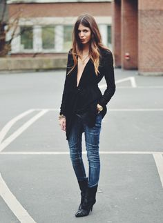 Wow! Love the fitted jeans, boots, and what about that neckline! Not sure I could pull it off where I live, but a night in the city maybe?