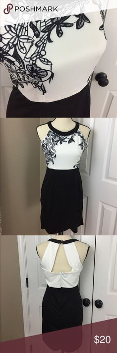 Elegant Women's Sleeveless Black and White Dress Brand new with tags Women's Sleeveless white and black dress size M. Very elegant. Form fitting and very flattering. Pet free and smoke free home. Please check out my other listings! Thanks! Dresses