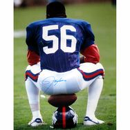Lawrence Taylor Autographed Sitting on Football and Helmet Vertical 16x20 Photo #LT #steinersports
