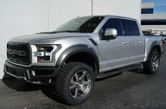 "2017 Ford Raptor Silver • 22x9.5 DUB 6SIX Wheels in Brushed Double Dark Tint • 35x12.50R22 Nitto Terra Grappler G2 (215580) • Traxda 2.25"" Front Leveling Kit (105010) • Pace Edwards BedLocker Tonneau Cover Kit (PEBLFA05A28) • BedRug Complete Truck Bed Liner (BEDBRQ15SCK)"
