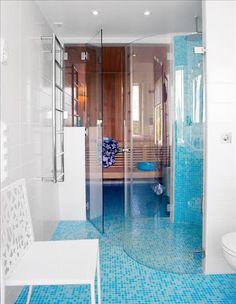 Shower in pool bath flooring  Bright blue bathroom tiling