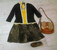 Saia estampa animal, blusa amarela, casaco marrom, bolsa e sapato caramelos.