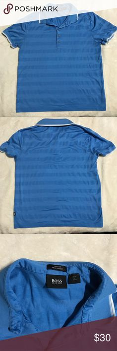 "Hugo Boss blue striped slim fit polo size large Excellent condition Hugo Boss blue striped slim fit polo. White detailing on sleeves and collar. Flat measurements: chest-20"", hips- 20"", length- 26"" Hugo Boss Shirts Polos"