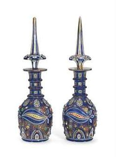 A PAIR OF BOHEMIAN ENAMELLED CLEAR-FLASH WHITE AND BLUE OVERLAY CUT-GLASS BOTTLES AND TWO STOPPERS
