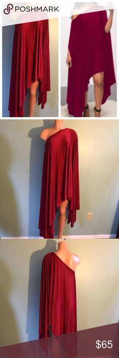 New Assemetrical Cape Dress Draping One Size Stunning! Boutique purchase I bought to go with sequin pants and then decided to wear pink. Color is Maroon or Burgundy. It's draped and comfortable. Holes for both arms to keep in place. It's a shiny, slinky material. One size fits most. Mannequin in photo stands at about 6'. Please ask any questions. Brand new and unworn. Bundle discounts and daily shipping. Happy Poshing! Boutique Dresses Asymmetrical