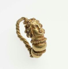 Hoop earring terminating in the head of a maenad Greek, Hellenistic Period, about 250–160 B.C. Hoop-shaped earring, ending in a maenad's head crowned with ivy. The hair is pulled back in a bun at the nape of the neck, with twists of hair at the side. Two large gold beads bordered with beaded wire form a collar below the head. The hoop itself is twisted wire.