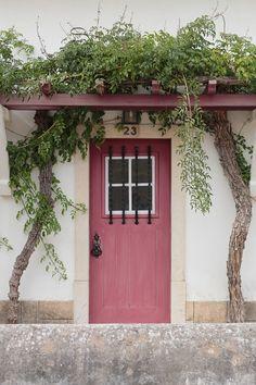 a pink door in portugal