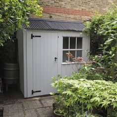A simple, narrow lean-to garden shed; but it could store a lot of garden tools!
