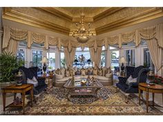 3373 Rum Row, Naples, FL 34102 | Formal living room with a water view in Port Royal. - Naples Seaside Properties