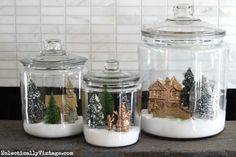 Have a few extra storage jars sitting around? Use them to create adorable little Winter Village Jars.