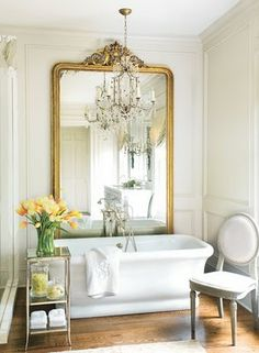 This ornate mirror really gives this bathroom the wow factor! We bet it looks incredible in the evening, with the chandelier twinkling in front of it #mirrors