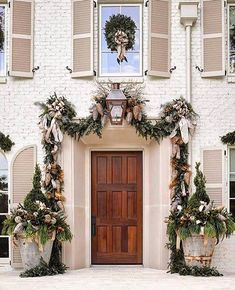 We are in love with this stunning doorway. I have to admit that I am not ready to take down Christmas decor. Every day left of Christmas is going to be taken in and cherished. 🌲❤️ . 📷:@brightyellowdoor Christmas Front Doors, Christmas Porch, Noel Christmas, Christmas Wreaths, Houses Decorated For Christmas, Christmas Entryway, French Christmas, Primitive Christmas, Country Christmas