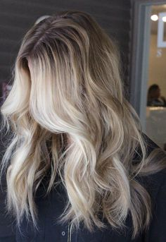 Dark roots and blonde loose curls!