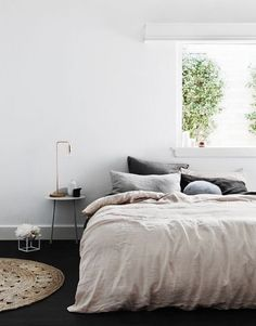 Neutrals in the bedroom with a black floor