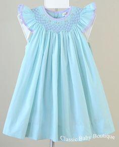 Blue dress with lavendar smocking and trim.