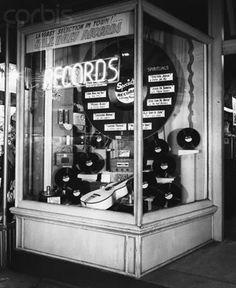 Largest selection in town ! vintage record store window display.