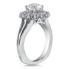 Diamond vintage halo engagement ring mounting with milgrain detailing and split shank in 14k white gold. Mounting to fit 1 ct. round center.