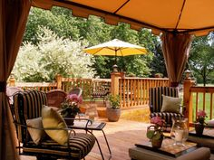 "This multilevel deck looks like a golden spot to spend an afternoon. The upper level is designed for dining, the middle level includes an outdoor kitchen and canvas gazebo for entertaining and relaxing, and the lower level includes a chair and small inflatable pool. ""It's great fun in a small space on a budget,"" says RMSer Trudie, who calls the space ""my little tropical retreat."""
