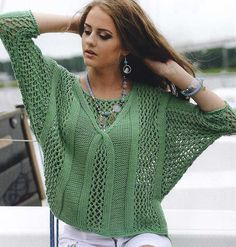 Sweater with wide sleeves and neckline on back