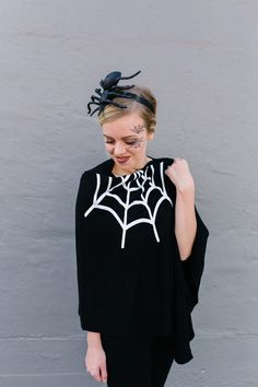 DIY Halloween Costumes: Women's Spider Web Poncho Costume - The Pretty Life Girls | Our favorite kind of DIY Halloween costume is easy, cheap, and fun and we are ready to get creative! Just start with a cape, add some simple embellishments and details and you are ready to get spooky! This first one is an adorable women's spider web poncho costume, made by using our Silhouette Cameo 4! This whole costume took maaaaybe 2 hours to put together and is so cute! #lastminutecostumes #costumeideas