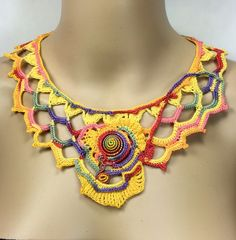 Free-form hand crochet Necklace with a colorful spiral focus...How fun is this? by GailsYarnworks on Etsy