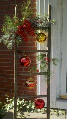 Christmas Ladder With Glass Ornaments - maybe next to front door (made with tree branches??)