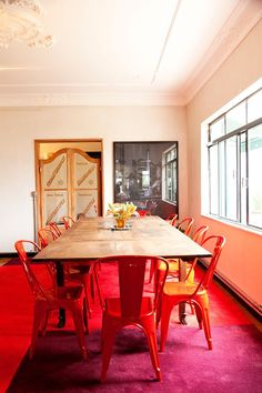 red chairs and swing doors to the kitchen...at Alex Hercovitch's home