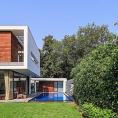Contemporary pool ahd shaded deck with a small pool house
