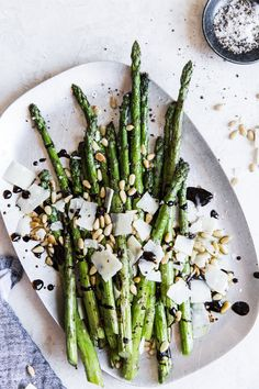 We've perfected the art of grilled asparagus, and we're celebrating by dressing it up with a balsamic reduction, parmesan and toasted pine nuts!