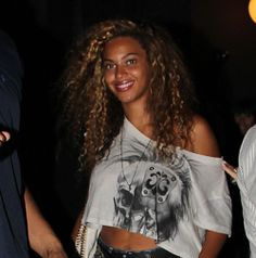 Beyonce's big curly hair looks fun and sexy and would also look great with different colors for a great punk touch.