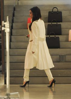 Victoria Beckham smiles at her Dover Street store in London wearing all white | Daily Mail Online