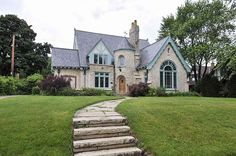Exquisite French Lannon stone home with old-world charm & superior craftsmanship.Sunken Great Room with Palladian window, stained glass accents & wrought iron. French Country Style, French Country Decorating, Abandoned Houses, Old Houses, Casas Tudor, Art Nouveau, Palladian Window, Gothic, Dream House Interior