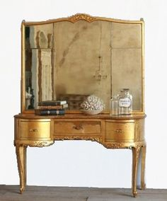 i have one of these from my childhood. Slightly different. It has 3 panel mirrors, no center drawer and two more drawers above the side ones.   #onekingslane #designisneverdone