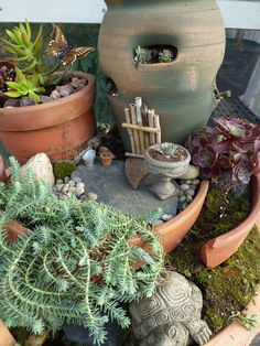 Kathy and crew at Willey Farms really used their imaginations: A door out of a bamboo plant support on a strawberry jar 'house'. A birdbath Christmas ornament sprayed with stone paint made a little planter. A slate rock is a patio. A tractor piece is the front step.