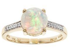 1.09ct Round Ethiopian Opal With .07ctw Round White Zircon 10k Yellow Gold Ring