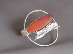 Two finger sterling silver ring with sonora sunrise stone.  Wearing it says is all!