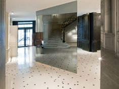 Maison Martin Margiela have completed their first hotel interiors at the Maison Champs Elysées in Paris. Mirrored stairs